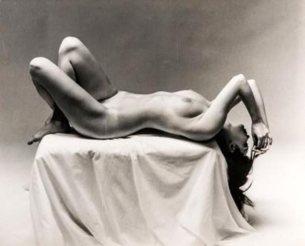 Nude Laying On Pedestal by Andre De Dienes