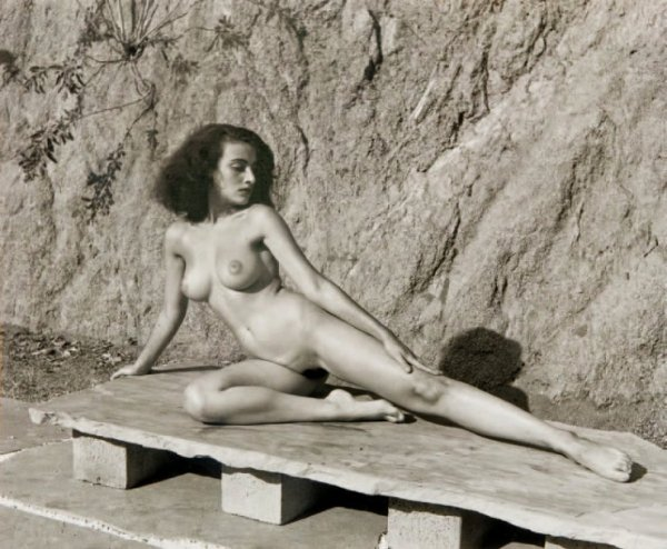 Nude On Stone Bench by Andre De Dienes