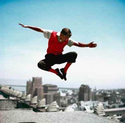 Sammy Davis Jr In Mid-air by Frank Worth