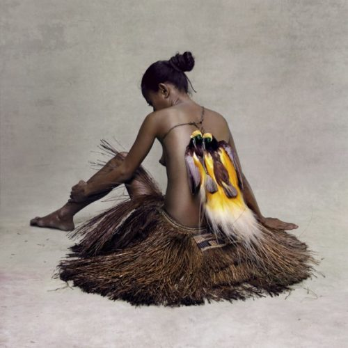 Young Woman With Paradise Birds, New Guinea by Fred Stichnoth