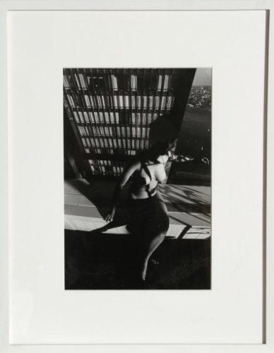 Nude On A Ledge by Lucien Clergue at