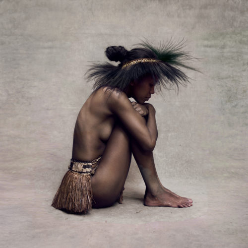 Young Woman With Paradise Bird Headpiece, New Guinea by Fred Stichnoth