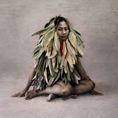 Young Woman In Leaf Costume, New Guinea by Fred Stichnoth