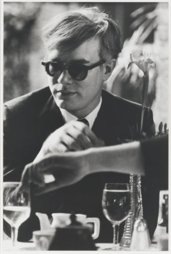 Andy Warhol (at table) by Dennis Hopper at Leslie Sacks Gallery (IFPDA)