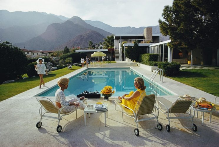 Poolside Gossip 1970 – Oversize C Print Open Edition by Slim Aarons at Slim Aarons